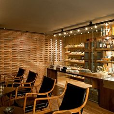 Dude Cigar Bar by Studiomake. Clever brick arrangement that allows glimpses into and out of the space.