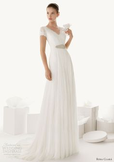 2d1271fa6c6 Beatriz short sleeve wedding dress featuring lace and tulle overlay with  knit underdress. Modest Wedding