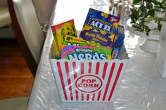 A popcorn prize pack for your baby shower! Candies and popcorn with a huge bucket that everyone will love and need