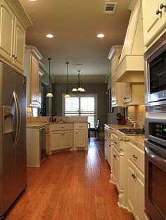 Kitchen island with columns artisan woods kitchens for Galley kitchen with breakfast nook
