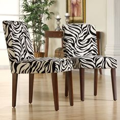 Update your dining room in an instant with these striking print dining chairs. Each chair features cherry-finished wooden legs, plush padding for comfort, and bold zebra-print upholstery for a dramatic, modern addition to your interior decor.