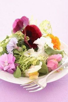 Edible flowers on spring greens....lovely for a garden party