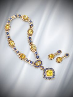 18 karat gold, sapphire and diamond pendant-necklace and earclips, Van Cleef & Arpels. More than 250 carats worth of yellow and blue sapphires combine beautifully in this necklace and earclips set from a New York estate.