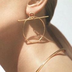 A Collectio - gold earrings - hoops - detail