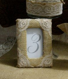 burlap and lace frame covers table numbers