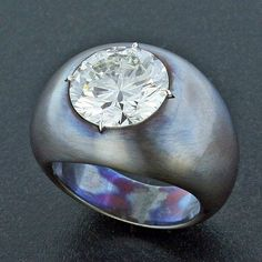Large Diamond in a blued steel and platinum mounting.