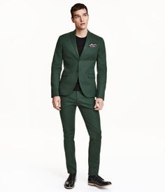 uit pants in woven, premium cotton stretch fabric. Extended waistband with concealed fastener, side pockets, and welt back pockets. Slim fit.   H&M Men's Classics