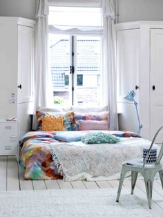 bedroom white with pops of colour.