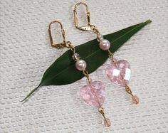 Here are my latest earrings made of Light Pink Swarovski Glass Pearls, Czech Pink AB Crystal Beads and GP Lever Back Ear Wires. For details about these earrings or to purchase them, click on the Etsy link below. Pink Heart Swarovski Crystals Articulated by AdornmentsByEloise, $32.00 Thanks for browsing! Eloise
