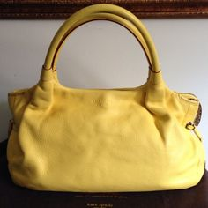"""Kate Spade yellow Stevie Approximately 16""""x8.5""""x5.5"""".  Authentic Kate Spade!  Leather is so soft and beautiful.  Used a handful of times so it's still in a great condition.  Handles show some discoloration (see pic) and inside is clean.  No dustbag, sorry. kate spade Bags"""