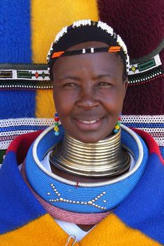 """Ndebele woman with ndebele neck rings . Shaun Leane made a coiled neckpiece for McQueen's collection """"It's a Jungle Out There"""" (Autumn/Winter which was inspired by the coiled brass and copper neckpieces worn by the Ndebele women in South Africa."""