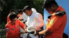 Indonesian officials have expanded their search area as the hunt for missing AirAsia flight QZ8501 goes on.