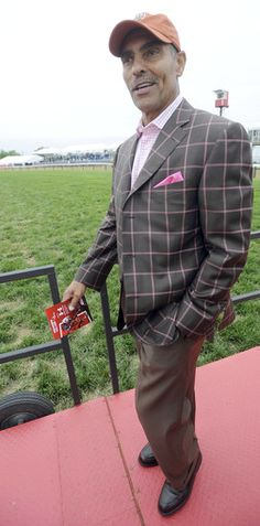 At Preakness 2013, Herman Edwards, analyst and former coach of the Kansas City Chiefs, shows off his style. Edwards said his wife always chooses his outfits and his daughter selects his socks.