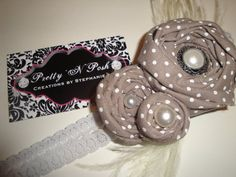 Adult rosette cluster headband made with grey polka dot cotton fabric, pearl buttons, ivory ostrich feathers on an icy grey stretch lace headband!!