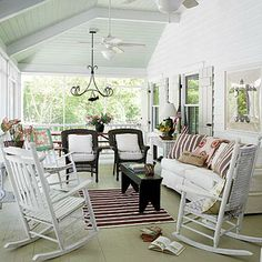 L.L.Bean rocking chairs make this screened porch the perfect place to relax. | Coastalliving.com