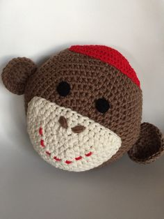 Morgan is our fun loving sock monkey pillow. Hand made with love he is approx. 14 diameter and is made with coco brown, creamy white and red. He adds quite a bit of flair to any room! Our original design and pattern © Copyright 2010 Crochet Sock Monkeys, Crochet Penguin, Crochet Socks, Crochet Animals, Crochet Pillow Pattern, Crochet Patterns, Pug Pillow, Handmade Pillows, Animal Pillows