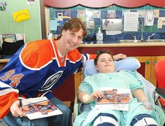 Ryan Smyth visiting with patients at the Stollery Children's Hospital during the annual Oilers hospital visits - March 2013 Edmonton Oilers, Childrens Hospital, Athletes, Little Girls, Photo Galleries, Copper, March, Blue, Toddler Girls