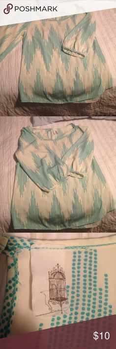 Very soft flowing blouse Green and cream colored shirt. Very lightweight and flowing. Pearl button detail at back of neck and mid arm. I do not know the brand of the shirt , it has a birdcage on the tag. I bought it at a boutique.  Size small made in the USA. Tops Blouses