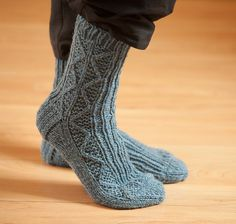Heavy worsted weight or aran yarn makes durable and quick to knit boot socks using 4 needles in the round. Design is easy yet interesting to work. Shown in Briggs and Little Tuffy. #knitwisedesign
