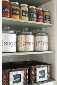 pantry, so organized and cute - Love teh vinyl letters on the glass jars Love the idea of having designated bins in the pantry for lunch and snack things