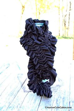 Very cute, very easy.  I made a couple scarves like this for gifts. I was wondering about the shifting of the ruffles...loved her backstitch idea.
