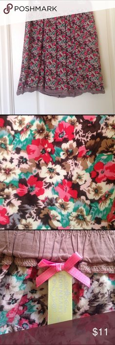 Downeast Floral Skirt Downeast floral skirt, very cute for Spring. Brown, beige, pink, red, green& gray floral design w a taupe/ tan elastic waistband. 16 waist. 22 length from waist . Size L. Length hits me at my knees. Downeast  Skirts Midi