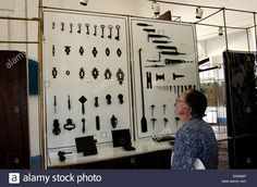 Museo de Arquitectura, man looks at a display of door fixtures and fittings of the 18th and 19th century, buildings built in 173 Stock Photo