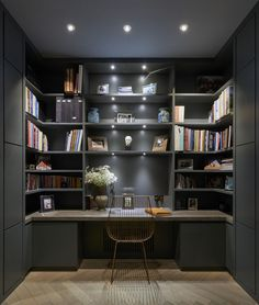 Contemporary dark home office in London by De Rosee Sa