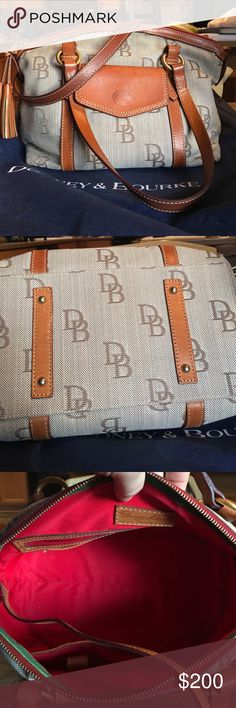 "Authentic Dooney & Bourke Handbag 💯% Authentic and in excellent condition. The smell of leather is intoxicatingly wonderful. Has key fob, three slip pockets and one zipped pocket all inside. Outside has a magnetic clasp closure pocket. Classic D&B jacquard with rich teak leather. An absolute beauty. 15"" in length, 10"" in height, 7.5"" in depth. 9.5"" strap drop. Sits perfectly in shoulder. Dooney & Bourke Bags Shoulder Bags"