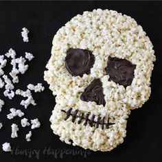 Popcorn balls get a make-over in this easy and clever white chocolate skull.  Get the recipe from Hungry Happenings.   - Delish.com
