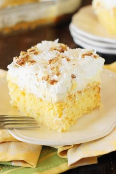Hawaiian Dream Cake ~ a layered delight with pineapple-and-coconut laced yellow cake base, layer of creamy pineapple pudding, and freshly whipped cream and coconut topping. Cool, creamy, & comforting!