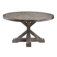 "Solid wood coffee table with a weathered grey finish.       Product: Coffee tableConstruction Material: Solid wood and birch veneersColor: Weathered greyFeatures:  Urban casual stylePlank style detailing on top Dimensions: 20"" H x 36"" Diameter"