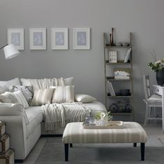 Give a country living room a contemporary twist with a modern interpretation. Start with country basics - weathered woods, ticking stripes and woven basketware - but bring in modern elements such as an L-shaped sofa, graphic artwork and a fresh colour palette of grey and white to mix things up