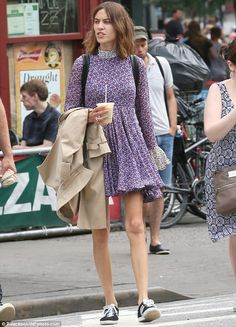 Pretty in patterns: The 31-year-old British beauty donned a floral patterned purple mini dress with Adidas sneakers
