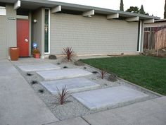 landscaped entryway for a modern bay area home, rocks pavers and grass