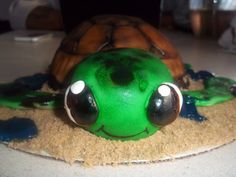Sea Turtle Cake  chocolate cake filled with chocolate buttercream, peanuts, and carmel, covered in fondant air brushed, brown sugar for the sand and blue piping gel for the water    www.facebook.com/cakes.sweettooth
