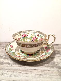 Beautiful Aynsley Tea cup and Saucer Indian Tree Teacup Bone China Made in England Pink Flowers Black Greek Key Gold Trim Scalloped A1173 by OneStopSteamShoppe on Etsy https://www.etsy.com/listing/480519547/beautiful-aynsley-tea-cup-and-saucer