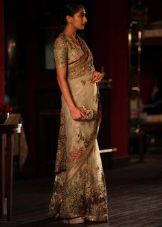 Model walking the ramp in peach and beige saree for sabyasachi collection during Indian couture week July 2014 - Kalkifashion.com