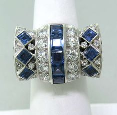 1980s David Webb Gold Platinum Diamond Sapphire Cocktail Ring   From a unique collection of vintage cocktail rings at http://www.1stdibs.com/jewelry/rings/cocktail-rings/