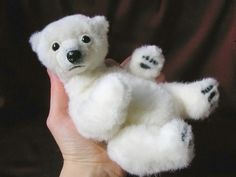 8 inches (20cm) polar bear cub Michaela. I made her of synthetic fur with needle felted details - muzzle, paw pads. Glass eyes, resin nose. 6 way cotter pin & disc jointed, wired arms and legs.