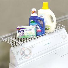 "Washing machine wire shelf mounts over the top of a washer or dryer, creating a space-saving solution for detergents. Keeps standard-sized bottles and boxes in convenient reach of adults---and off the floor. Made with a coated finish that won't scratch the surface of appliances. Easy assembly. Vinyl-coated steel wire, 10 x 26 1/2 x 1"".  $17.98"