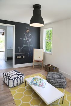Yellow and black playroom boasts a chalkboard accent wall lined with a dry erase… – Home Office Design On A Budget Playroom Storage, Playroom Design, Kids Storage, Wall Storage, Wall Design, Playroom Ideas, Toy Storage, Budget Storage, Modern Playroom