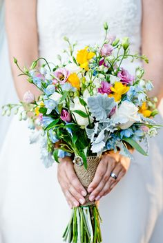 Style me pretty bridal bouquet using yellow freesias.