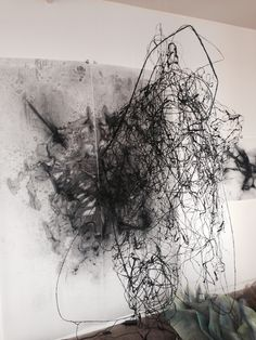 Julie Tremblay, 2014, Charcoal line sculpture (in progress) in front of 6 x 9 feet drawing