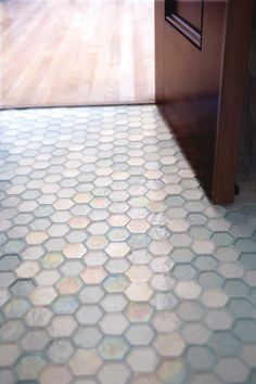Oceanside glass tile.. We LOVE the honeycomb tile. Such a unique look for any bathroom or kitchen.