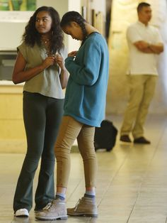 Sasha and Malia Obama wait for their father President