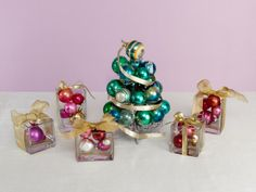 Centerpiece ideas from Food Network - Ornaments Off the Tree    Turn your cupcake tier and some simple square glass vases into a centerpiece that mimics a tree surrounded by presents.
