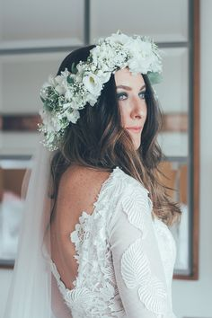 Bride wears a white flower crown for a Vintage Glam Inspired City Wedding. Captured by Remain in Light Photography