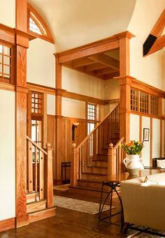 Stairway with divided light window cutouts, natural wood wainscoting battens