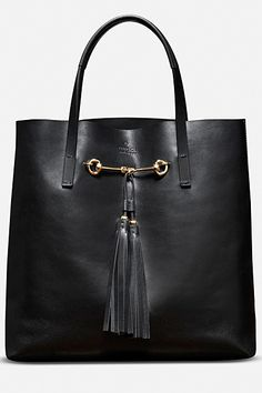 Gucci Tote Fall 2012. I could use something like this for school.... only much, MUCH cheaper. And perhaps without the tassels.
